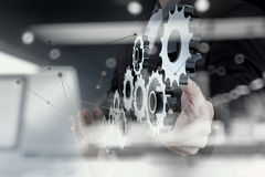 Double exposure of businessman hand show human gear to success Royalty Free Stock Photo