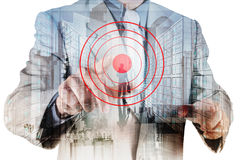 Double exposure of businessman hand shows target. Symbol as business concept Stock Photography