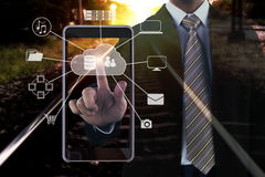 Double exposure of a businessman hand touching on smartphone. Connecting network in Cloud technology Stock Photography