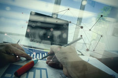 Double exposure of businessman hand working. With business documents on office table with laptop computer with social media diagram Stock Photo