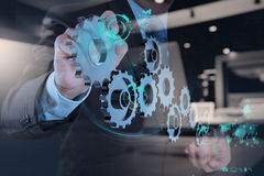 Double exposure of businessman hand working with cog gear Stock Photography