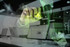 Double exposure of businessman hand working Stock Photos