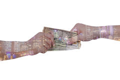 Double exposure of businessman hands exchanging money on city ba. Ckground with financial graph chart, business concept stock image