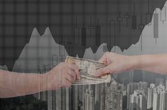 Double exposure of businessman hands exchanging money on city ba. Ckground with financial graph chart, business concept stock images