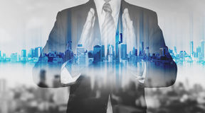 Double exposure businessman holding blue city hologram, real estate business technology Royalty Free Stock Photos