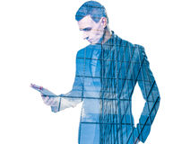 Double exposure of a businessman holding a tablet Stock Photography
