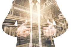 Double exposure of businessman with Industrial equipment Factory Stock Photos