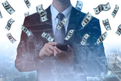 Double exposure of businessman making money by smartphone techno Royalty Free Stock Images