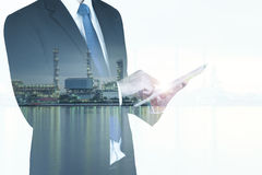 Double exposure of businessman with oil refinery industry Stock Images