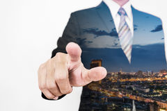 Double exposure businessman pointing finger to screen with skyscraper cityscape Stock Image