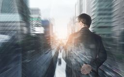 Double exposure of businessman standing back during building. royalty free stock photography