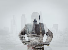 Double exposure of businessman stands successfully on building Stock Photography