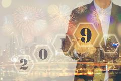 Double exposure of Businessman touching screen with welcome year stock images