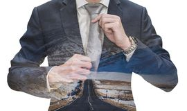 Double exposure businessman tying necktie with empty road, isolated on white background. S Royalty Free Stock Image