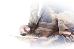 Double Exposure of Businessman use Computer Tablet with Airplane. And Cloud Sky as Transportation Business Concept Royalty Free Stock Image