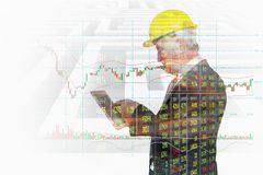 Double Exposure of Businessman use Wireless Digital Tablet Application connect with Candlestick and Bar graph Royalty Free Stock Photography