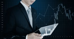 Double exposure businessman using digital tablet and raising graph diagram background. Business growth, investment, success and st Royalty Free Stock Images