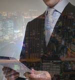 Double exposure of businessman using touch screen device Stock Photo
