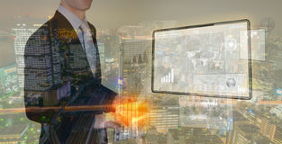 Double exposure of businessman using touch screen device Stock Image