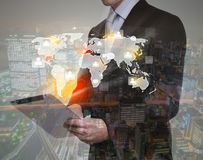 Double exposure of businessman using touch screen device Stock Images