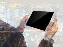 Double exposure of businessman using touch screen device Royalty Free Stock Photo