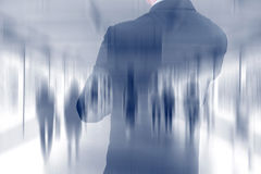 Double exposure of businessman and walking people Royalty Free Stock Photography