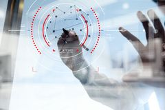 Double exposure of businessman working with new modern computer. Concept of focus on target with digital diagram,graph interfaces,virtual UI screen,connections royalty free stock photo