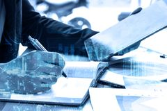 Double exposure businessman writes business plan with tablet royalty free stock photo