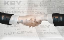 Double exposure of Businessmen shake hands,accept business cooperation agreements for partnership and investment,white brick wall royalty free stock images