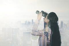 Double exposure of businesswoman with binocular stock illustration