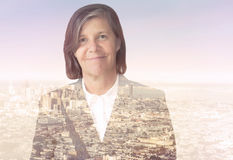 Double exposure of businesswoman and cityscape Royalty Free Stock Image