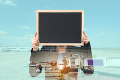Double exposure of businesswoman holding board with aeroplane Royalty Free Stock Photography