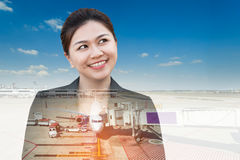 Double exposure of businesswoman thinking looking up with plane Royalty Free Stock Image