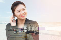 Double exposure of businesswoman using phone with aeroplane Stock Photography