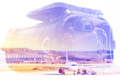 Double exposure: carrying case for the camera and an aircraft. Business and travel concept Royalty Free Stock Photography