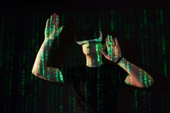 Double exposure of a caucasian man and Virtual reality headset is presumably a gamer or a hacker cracking the code into Royalty Free Stock Image