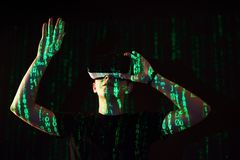 Double exposure of a caucasian man and Virtual reality headset is presumably a gamer or a hacker cracking the code into Stock Image