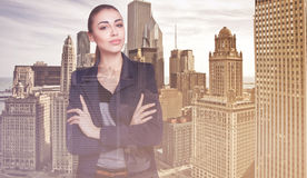 Double exposure of city and beautiful business woman folded her arms. Double exposurecity and beautiful business woman folded her arms Stock Photo