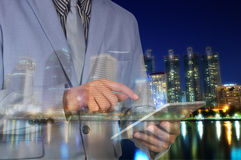 Double exposure of city and business man using digital tablet Royalty Free Stock Photo