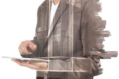 Double exposure of city and Businessman use Tablet device Stock Photo
