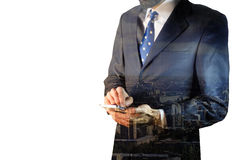 Double exposure of city and businessman. Using digital tablet Stock Photos