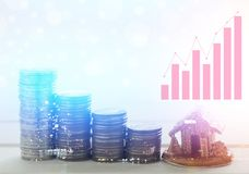 Double exposure of city and graph, pile of money coins and home, concept in finance, account growth, buying house. Double exposure of city and graph, pile of stock images