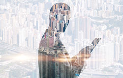 Double exposure of city and man using digital Stock Images