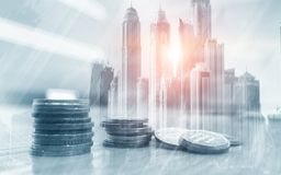 Double exposure of city and rows of coins for finance and banking concept. stock image