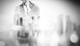 Double exposure of city and young business man royalty free stock images