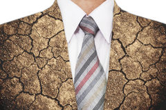 Double exposure, close-up businessman with cracked arid soil ground texture Stock Photos