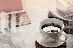 Double exposure of Coffee cup and Digital tablet dock smart  Stock Images