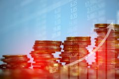 Double exposure of coin stack with stock market screen chart boa. Rd and candle stick for financial business and investor analysis concept idea Royalty Free Stock Image