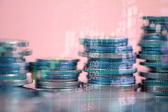 Double exposure of coin stack with stock market screen chart boa. Rd and candle stick for financial business and investor analysis concept idea Stock Image