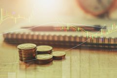 Double exposure of coins stack and graph for banking and finance. Concept stock photos